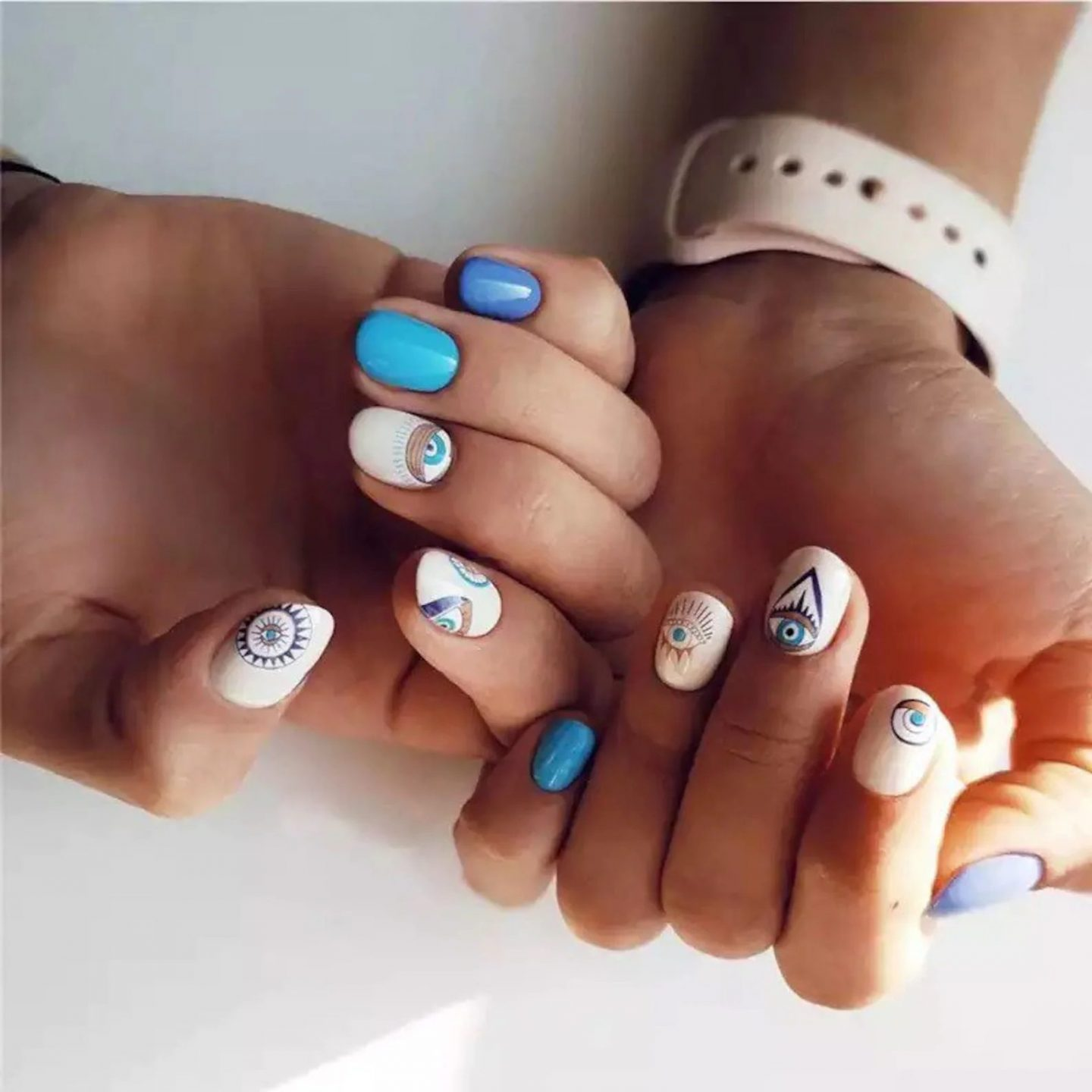 Short white and blue nails with evil eye