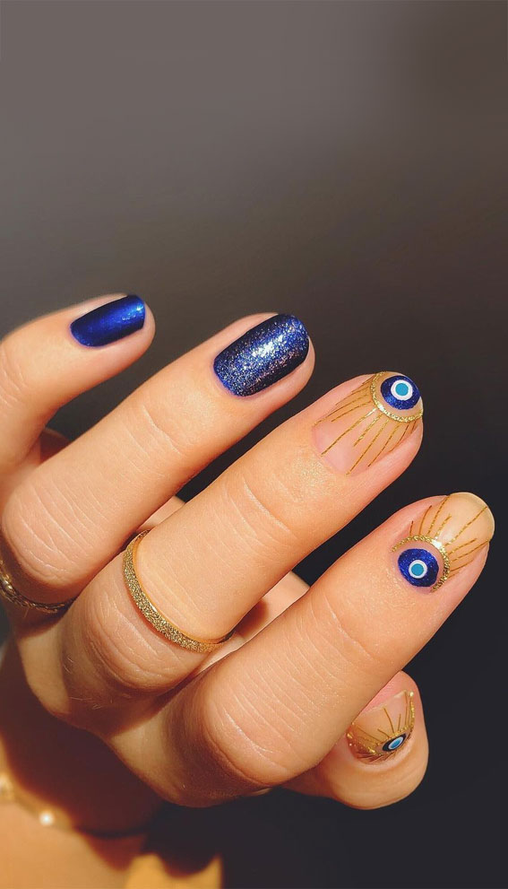 Cute short blue evil eye nails with gold