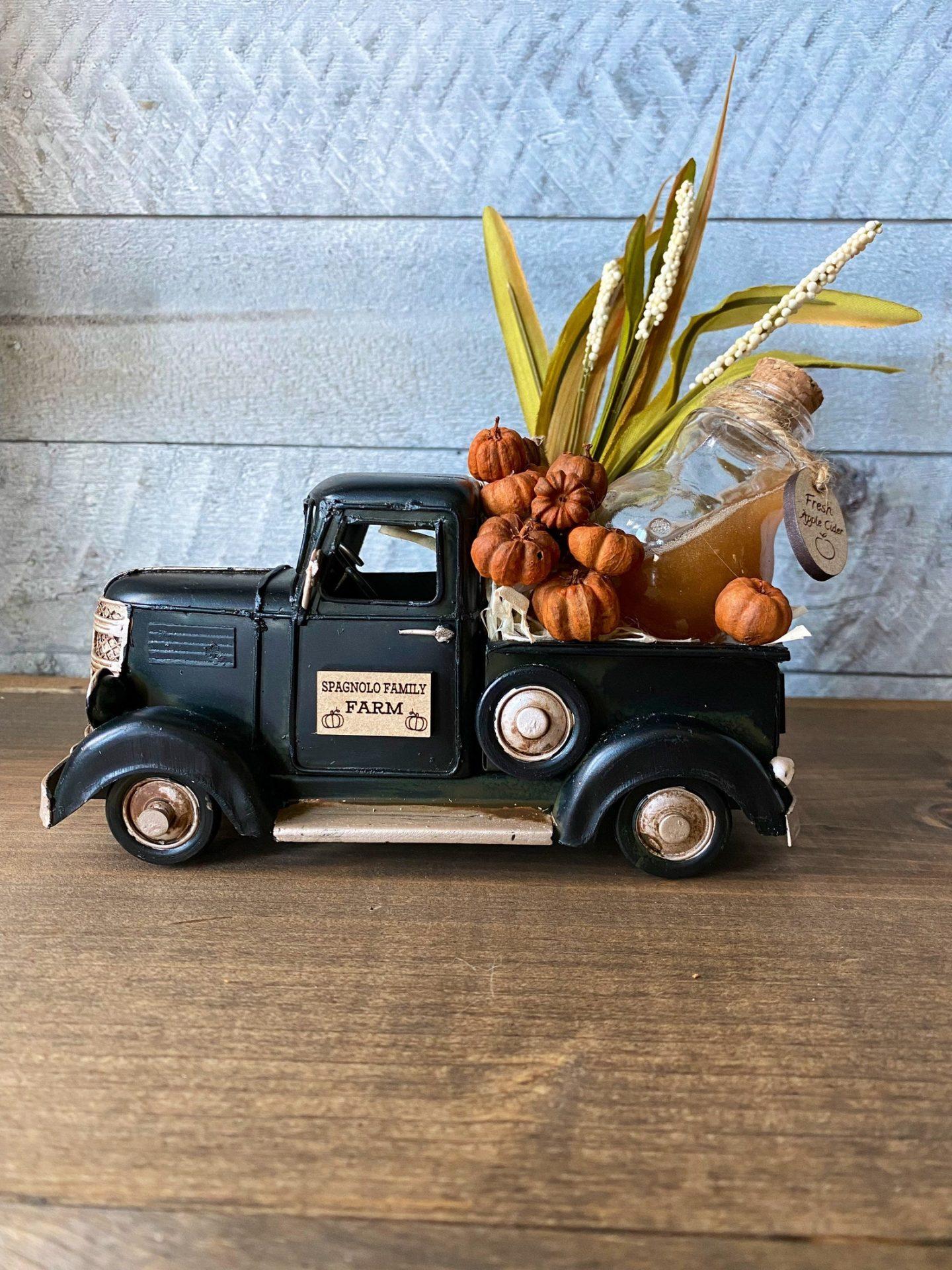 Cute farmhouse fall decor with farm truck centerpiece