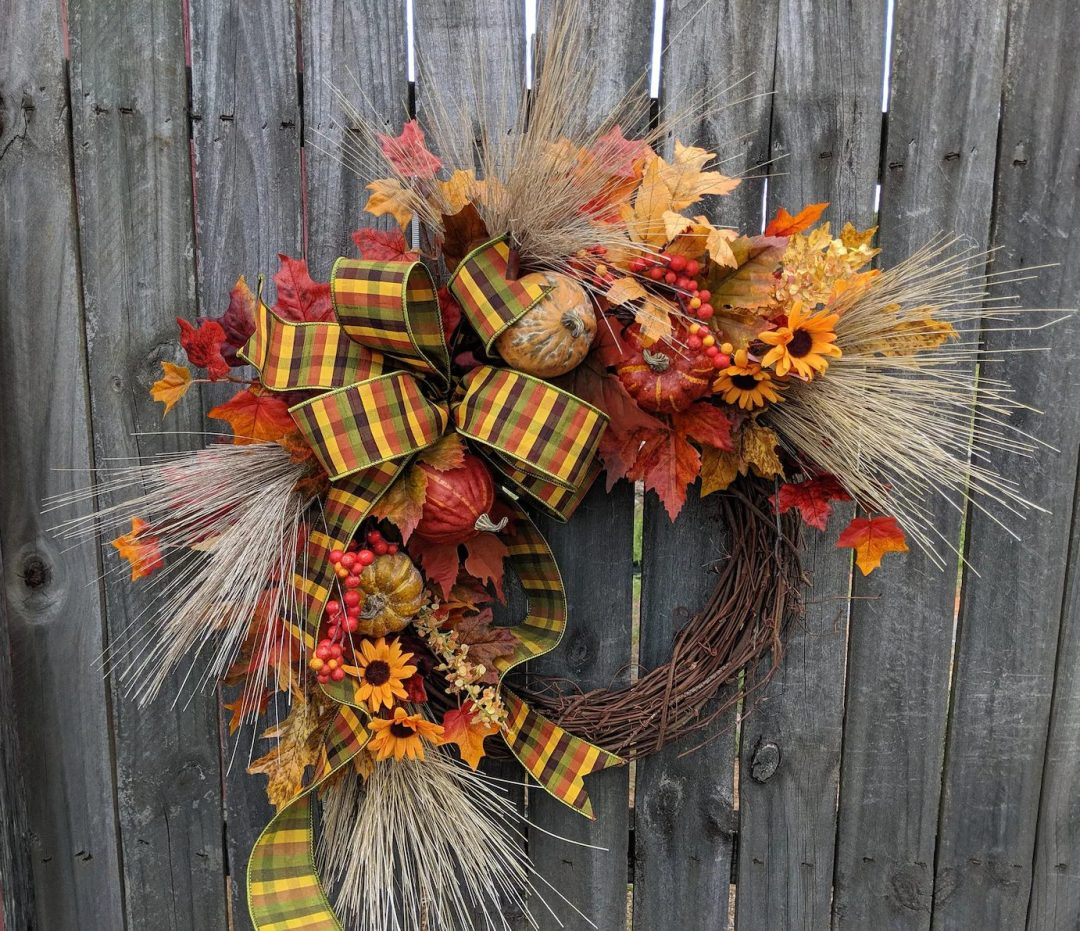 Straw fall wreath with pumpkins and sunflowers