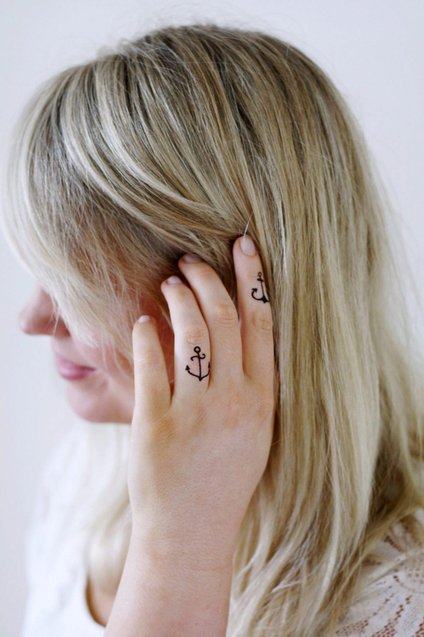 Cute anchor finger tattoos