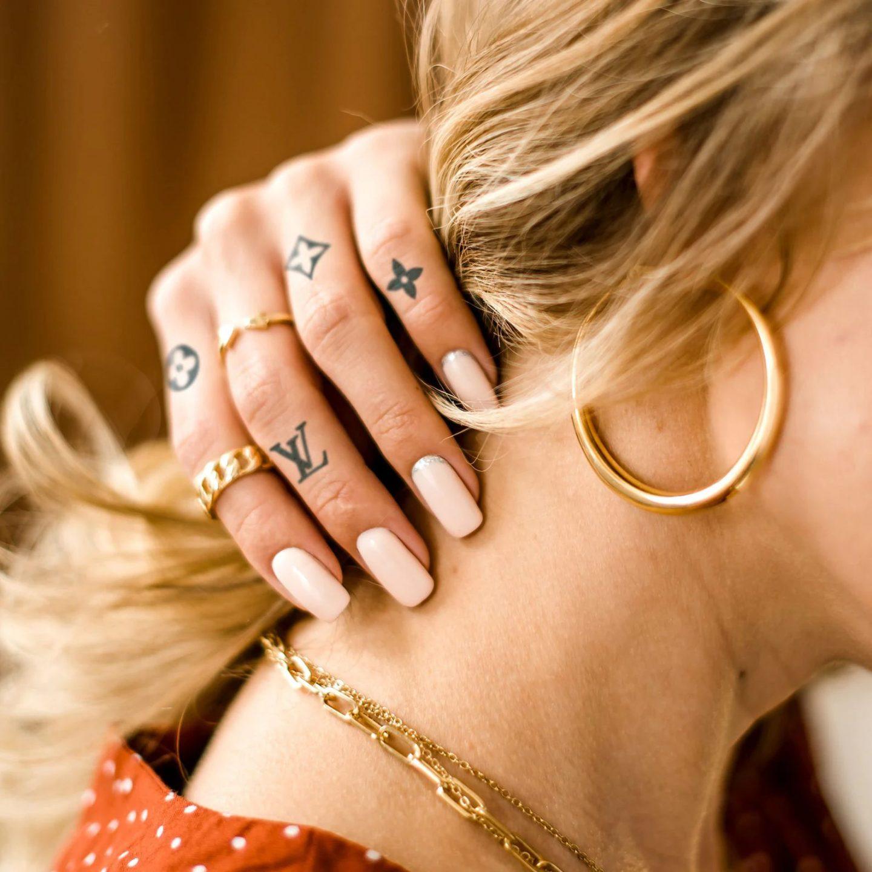 Designer inspired finger tattoos