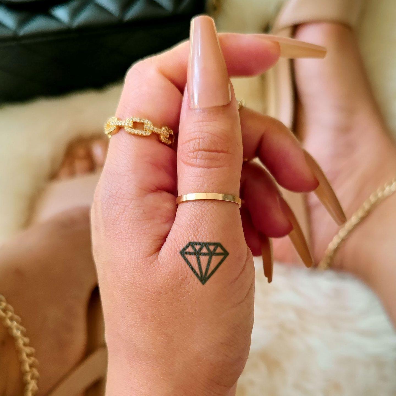 Cute dainty diamond finger tattoo