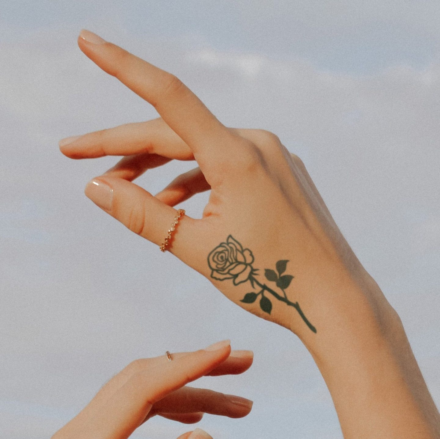 Cute rose tattoo for the hand