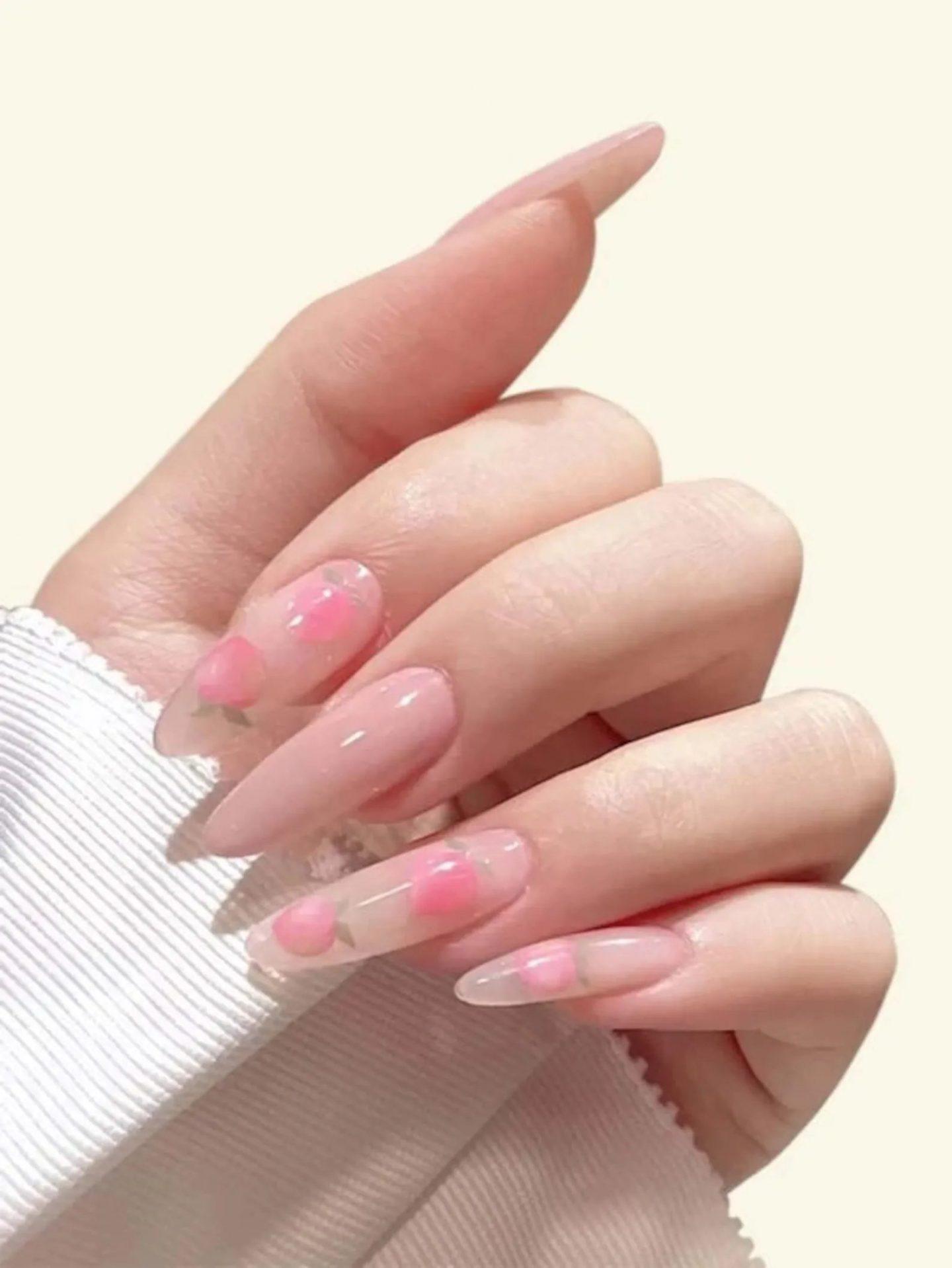 Long peach nails with nail art