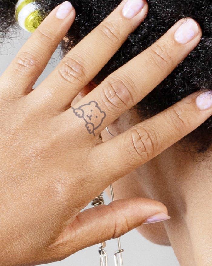 Finger tattoo ideas for females: Bear