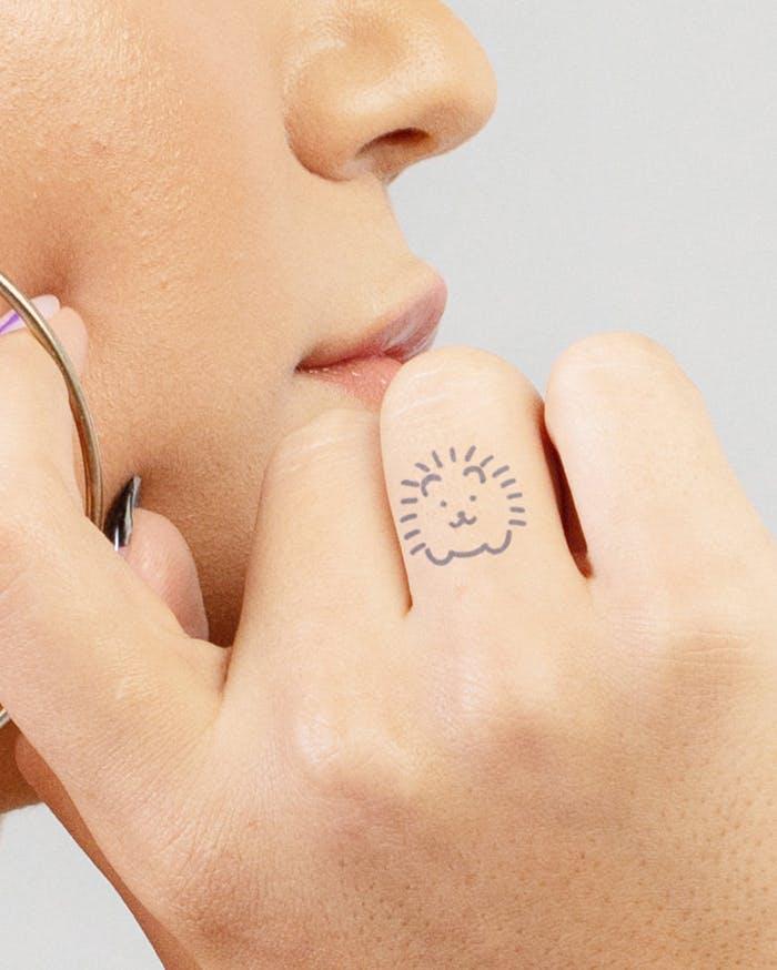 Finger tattoo ideas for females: Hedgehog