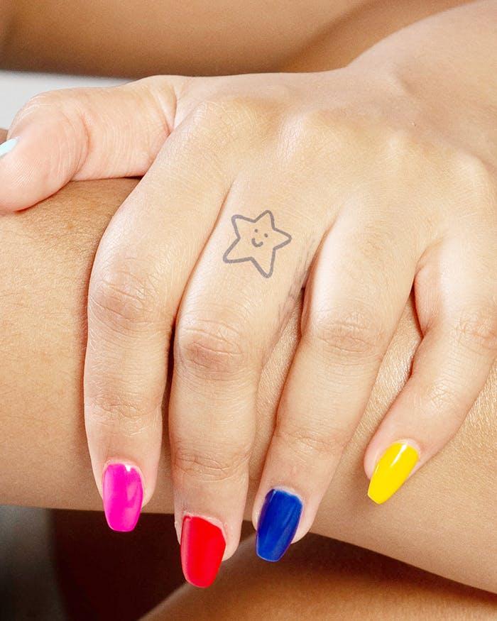 Finger tattoo ideas for females: Star