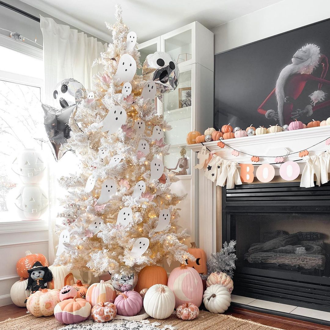 Cute pastel and white Halloween tree with ghosts