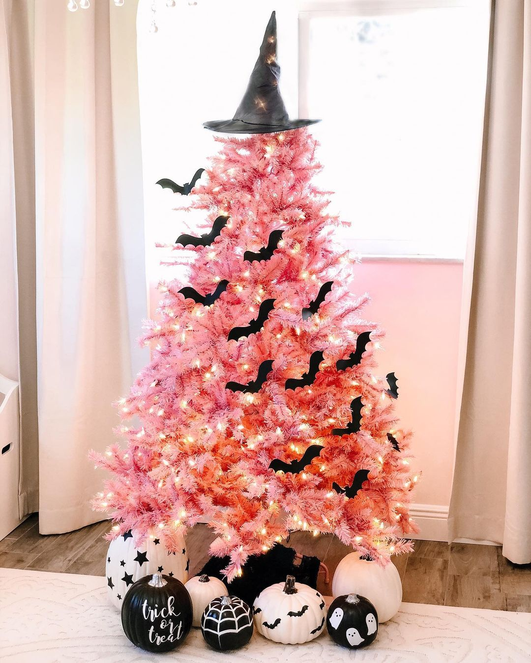 Cute pink Halloween tree with bat decorations