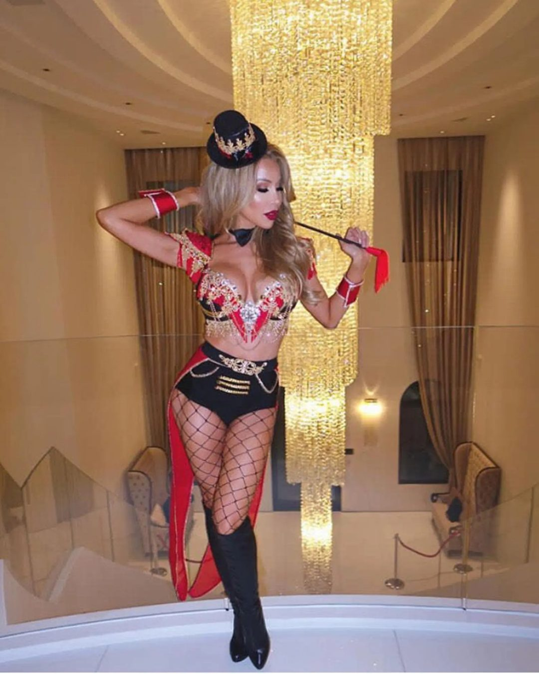 Ringleader with fishnets and hat