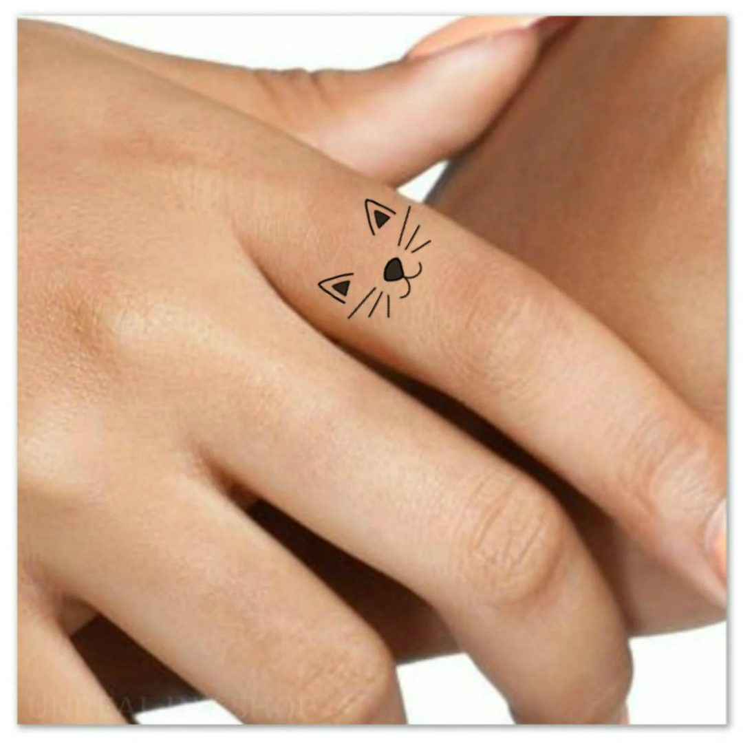 Finger tattoo ideas for females: Cat ears and whiskers