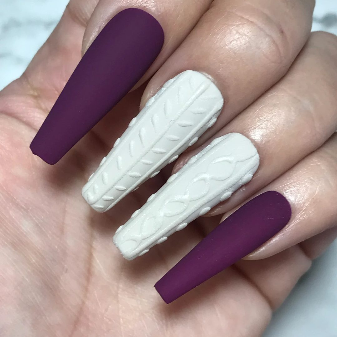 Plum and white sweater nails