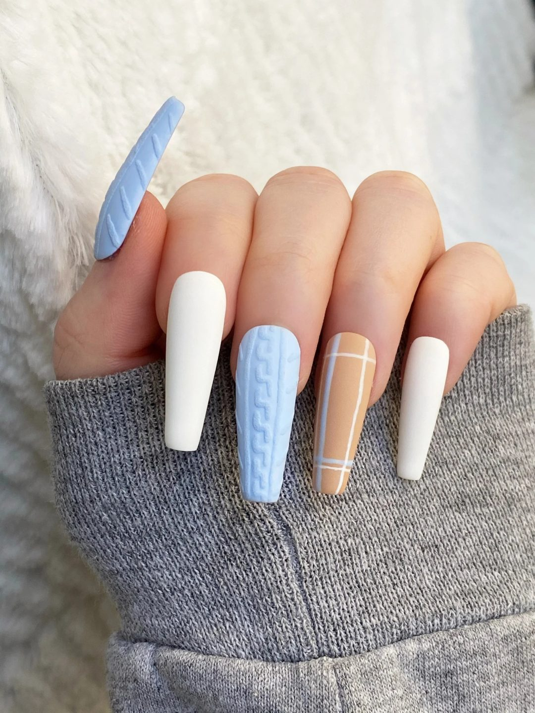 Baby blue sweater and plaid nails
