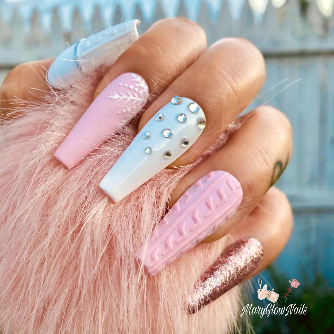 Pink and blue winter themed sweater nails