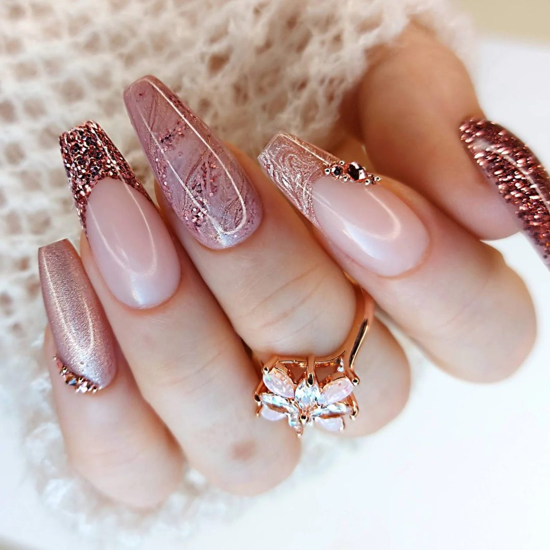 Rose gold nails with glitter and rhinestones