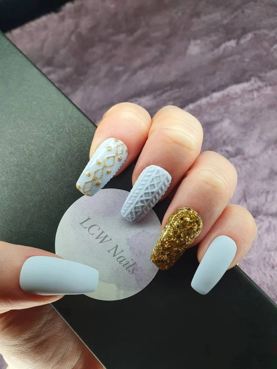 Powder blue and gold glitter sweater nails