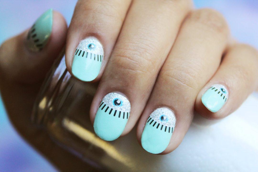 Mint green evil eye nails