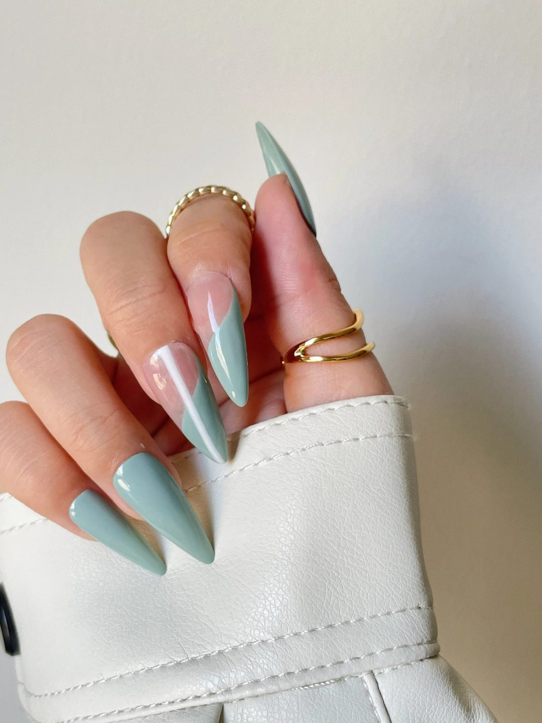 Sage green nails with negative space design