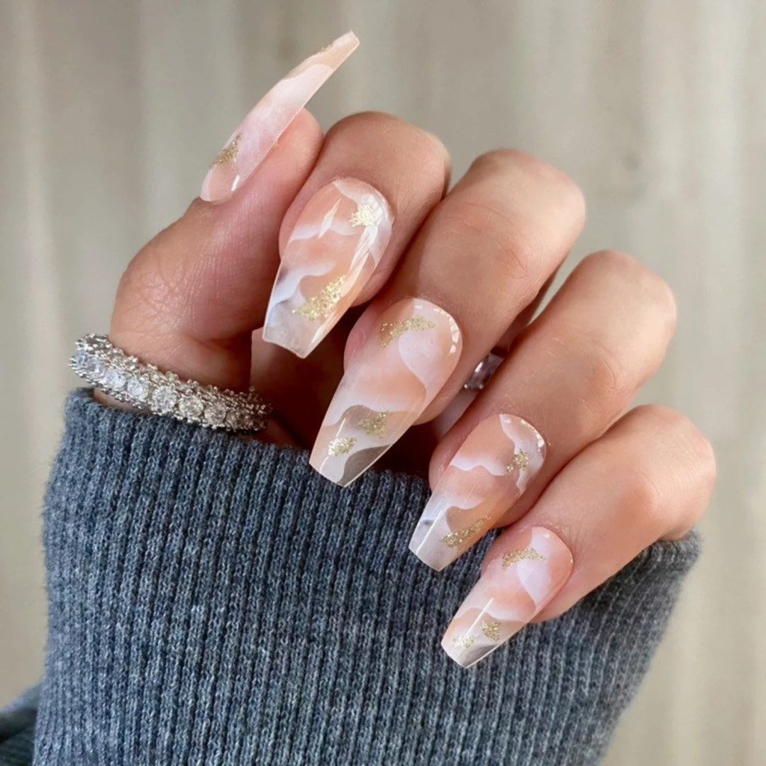 Smokey white swirl nails with gold detailing