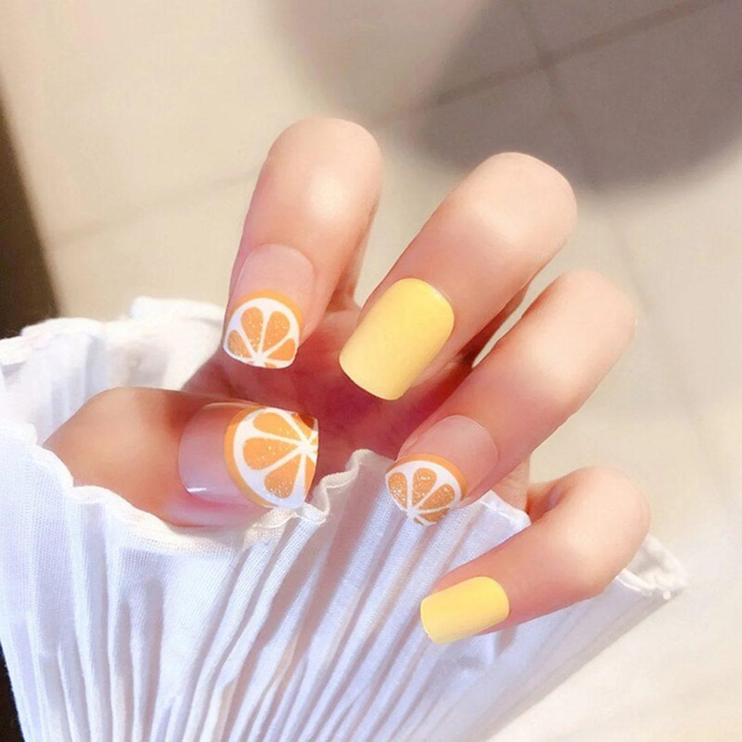 Pastel yellow and orange fruit nails