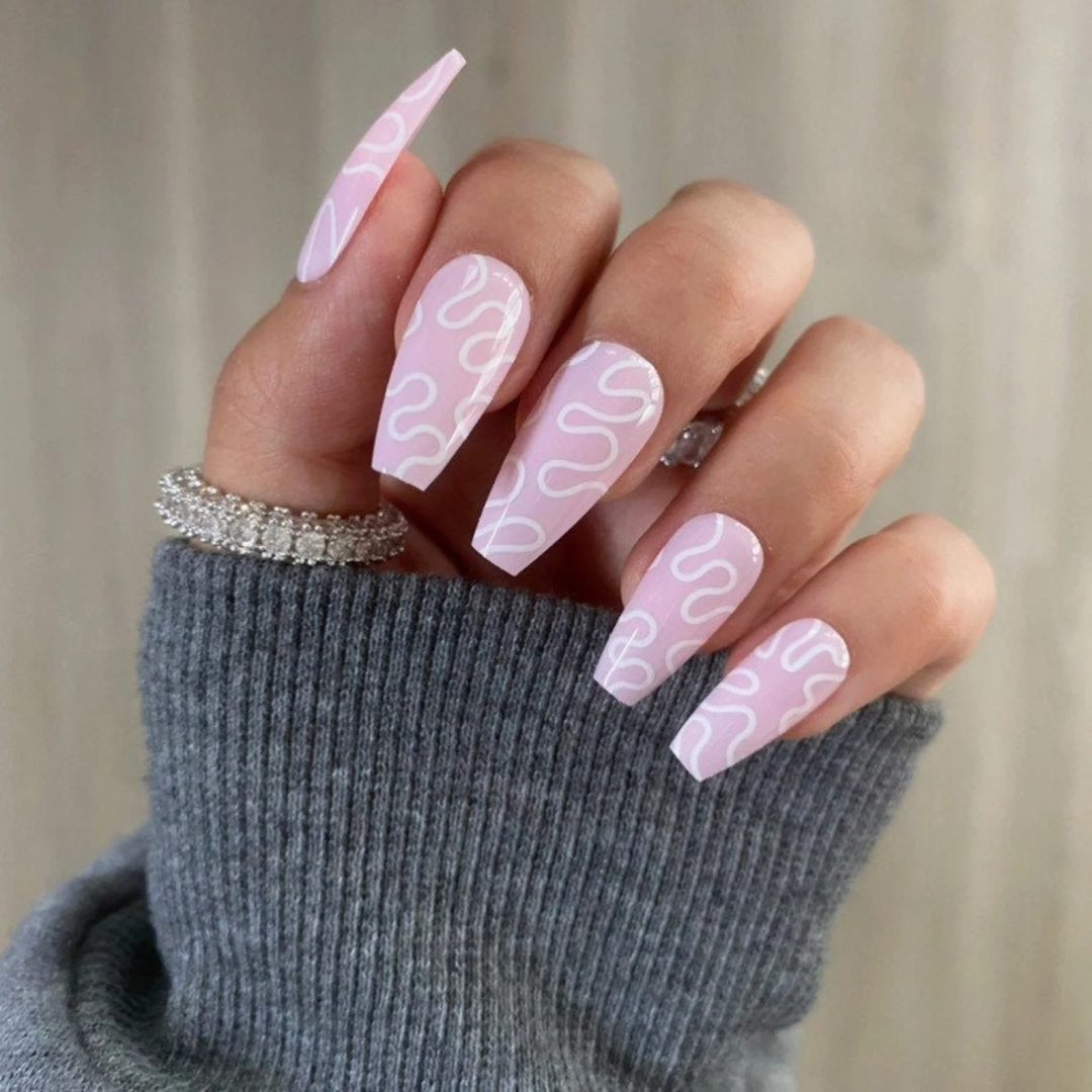 Pastel pink and white swirl nails