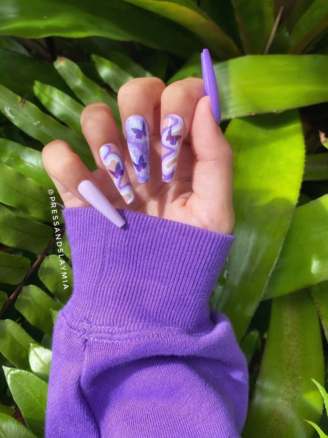 Multicolor purple swirl nails with butterflies