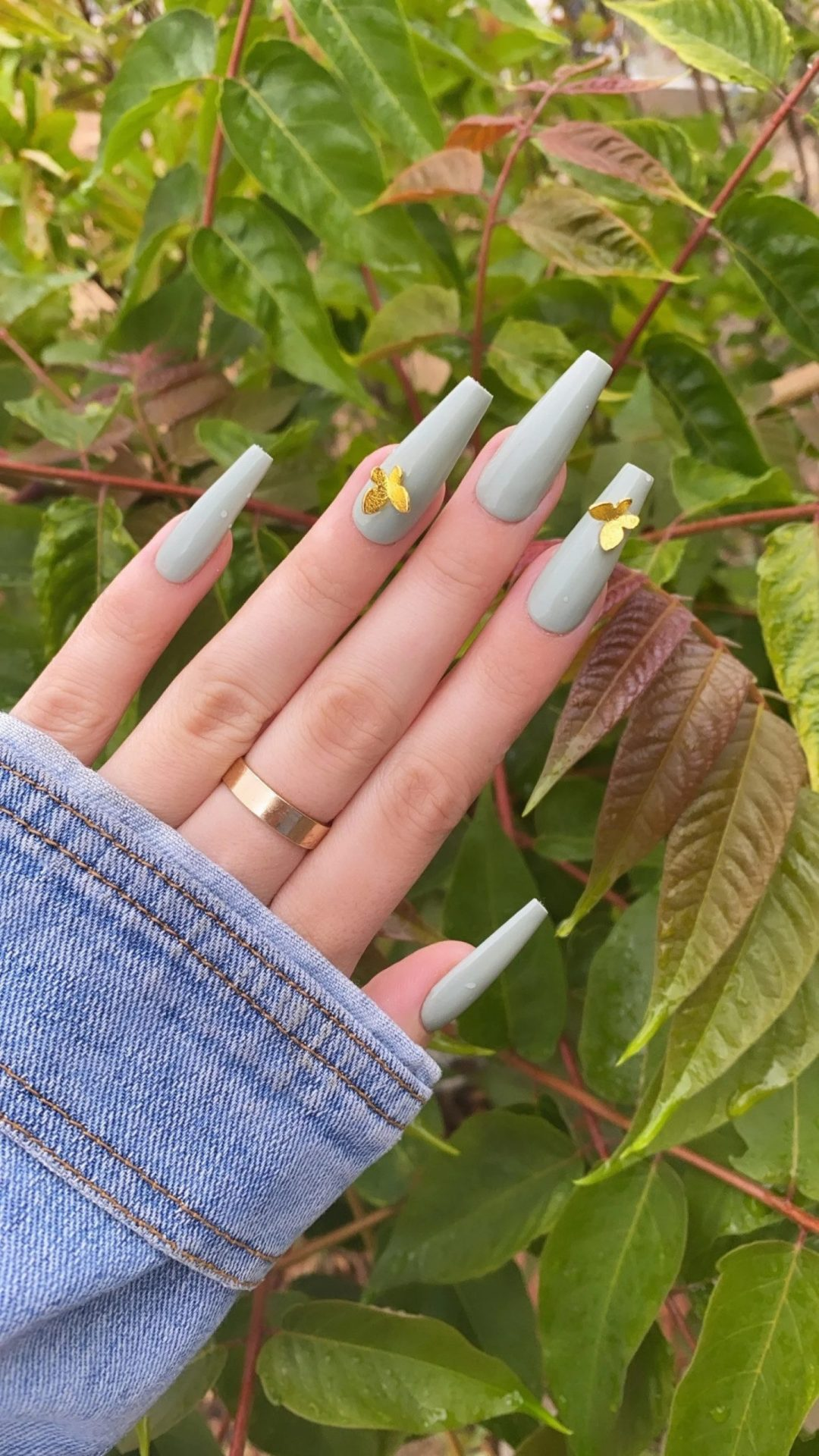 Pastel sage green nails with gold butterfly decals