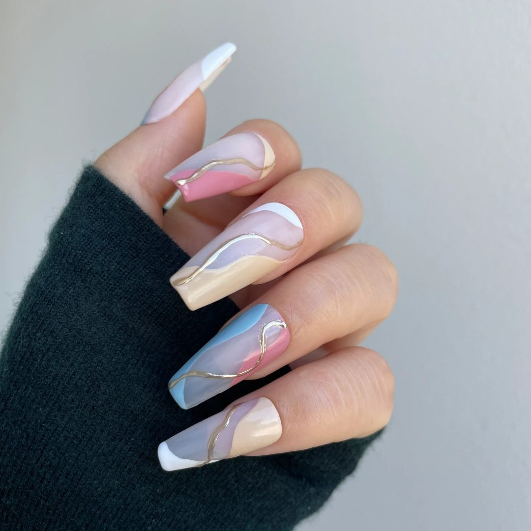 Pastel multicolor swirl nails with gold details