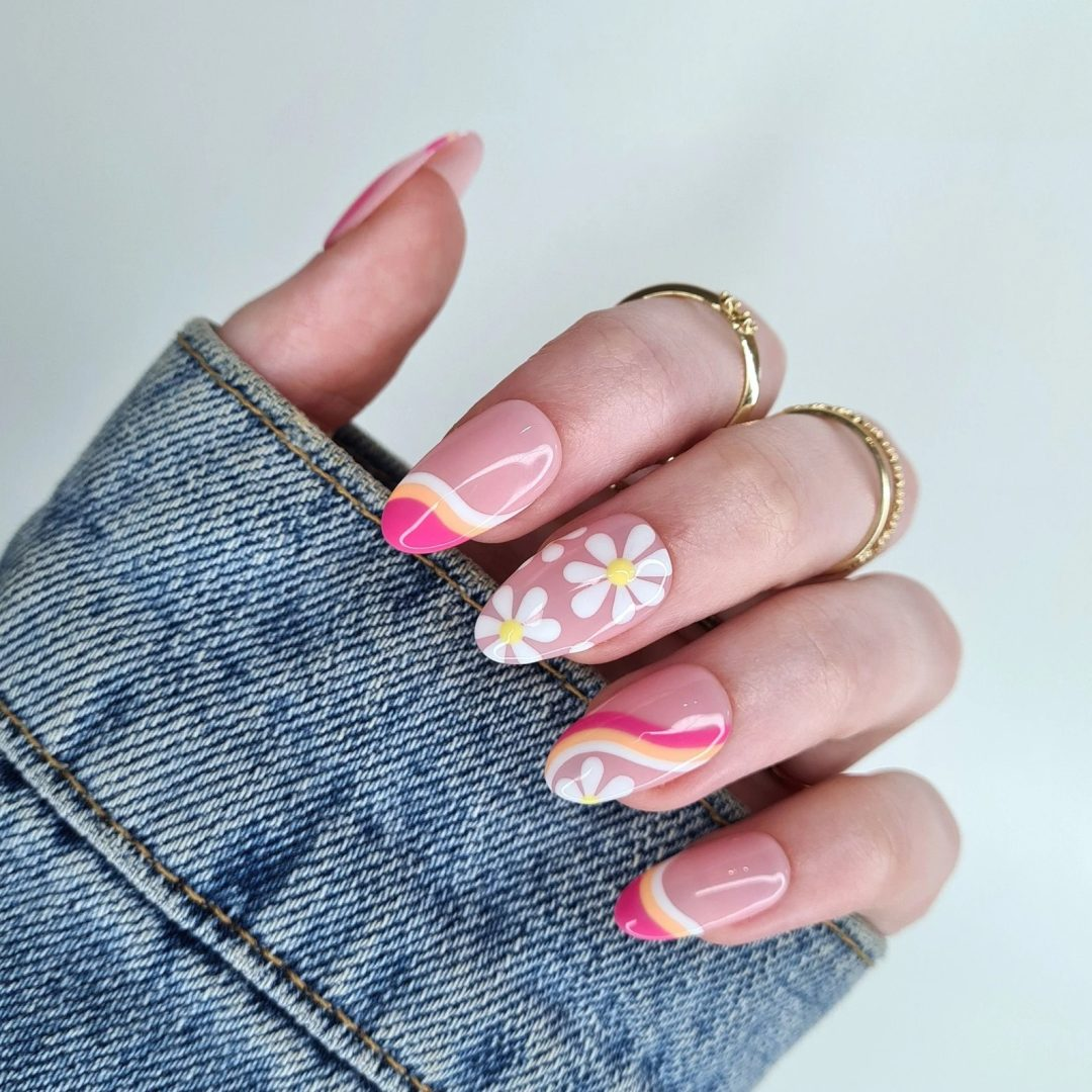 Swirl Nails: Multicolor swirls with daisies