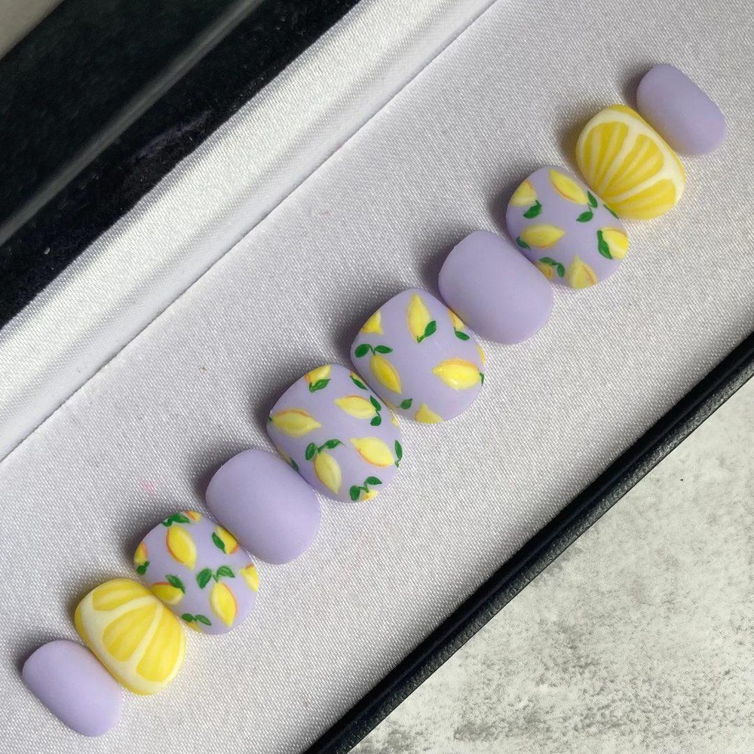 Matte lilac and lemon fruit nails