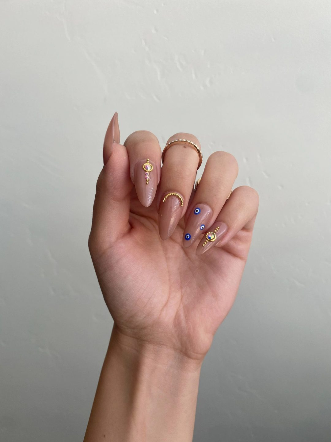 Evil eye nude nails