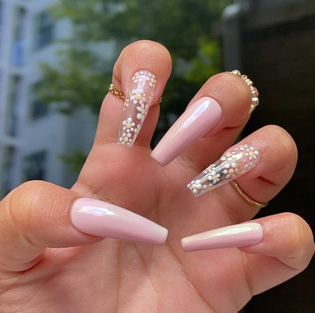 Clear daisy nails with pink polish