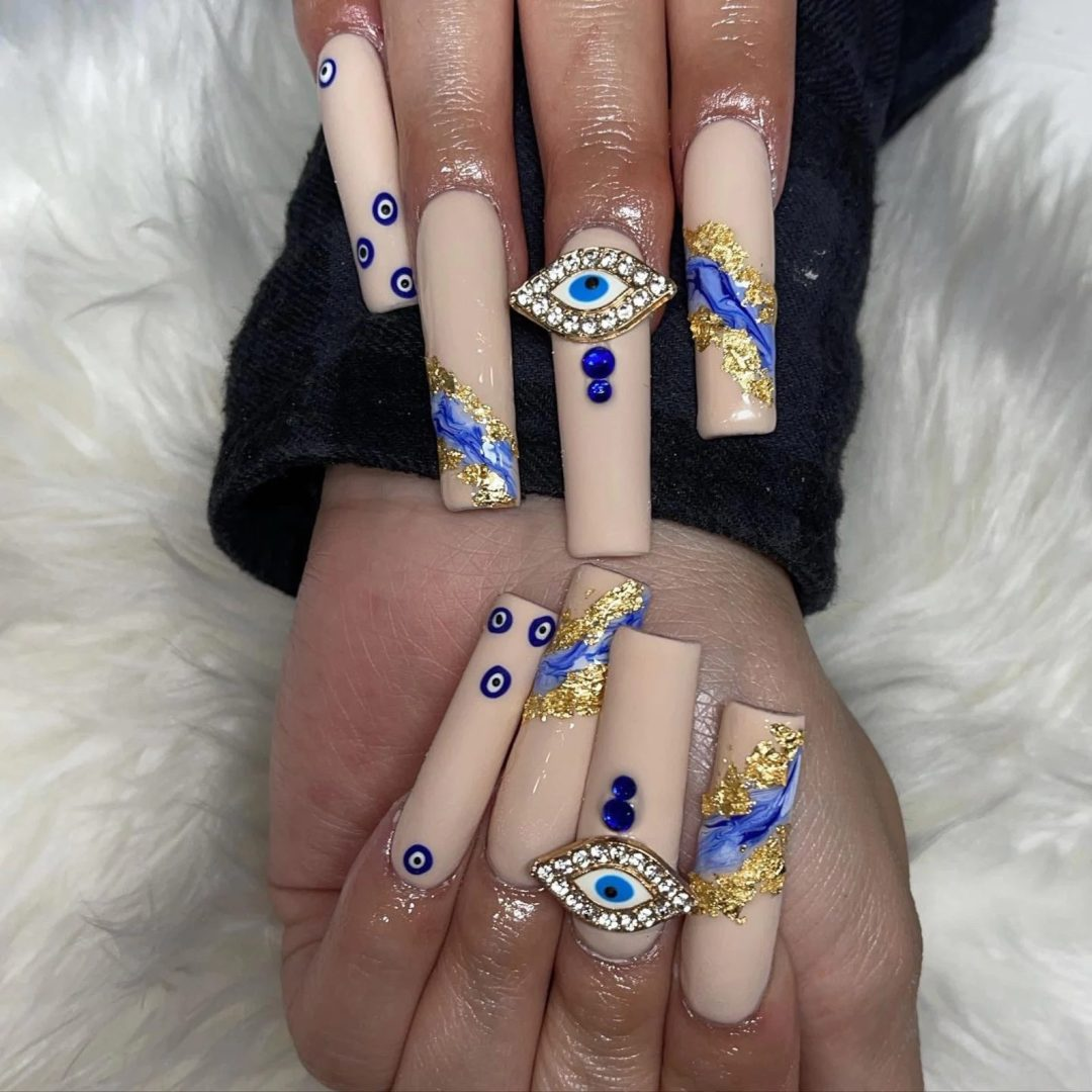 Nude coffin evil eye nails with embellishments and gold foil