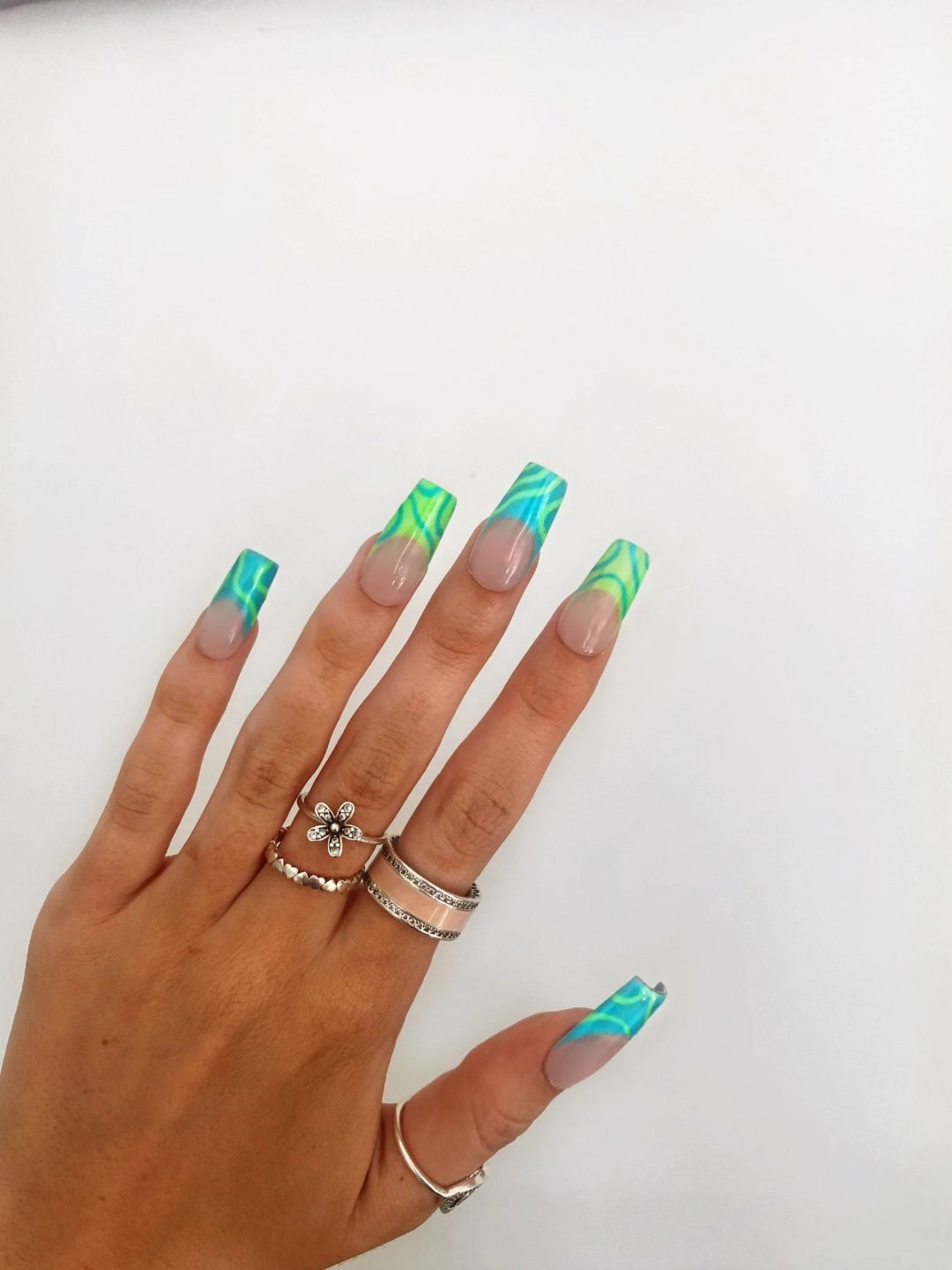 Neon green french tip swirl nails