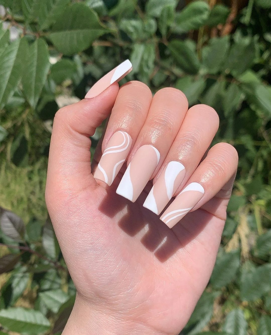 Nude and white matte swirl nails