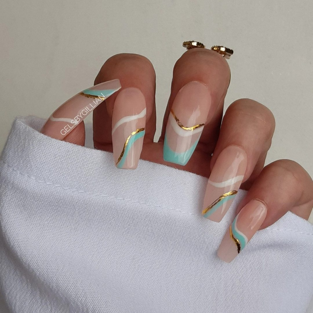 Teal, white, and gold swirl nails