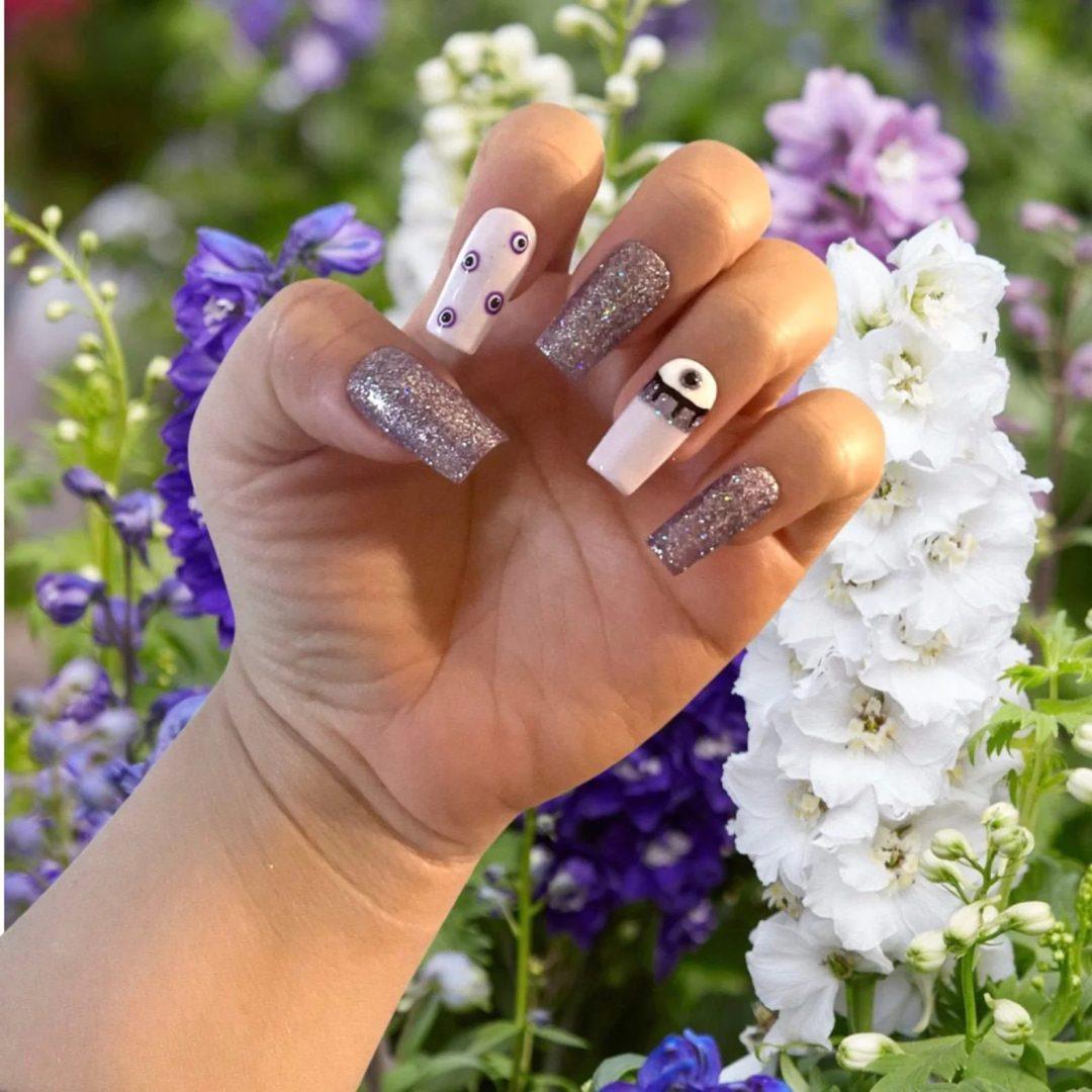 Mauve evil eye nails