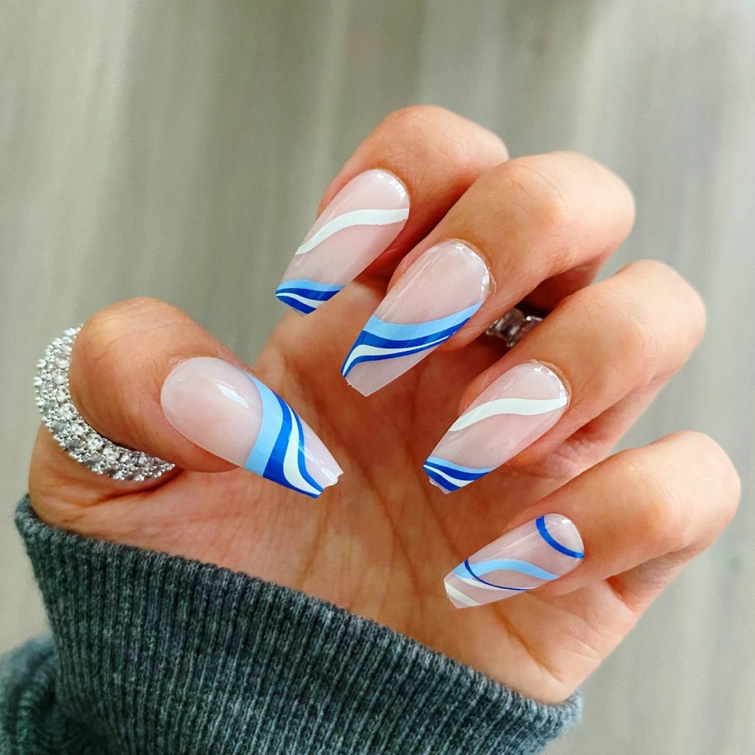 Blue and white swirl nails