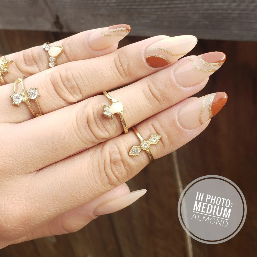 Brown swirl nails with gold detailing
