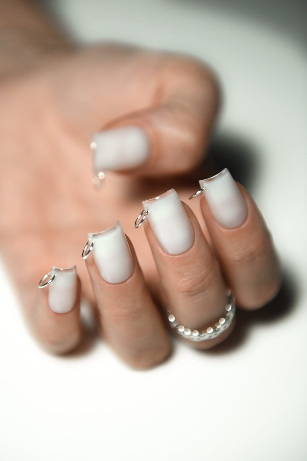 White square nails with silver pierce