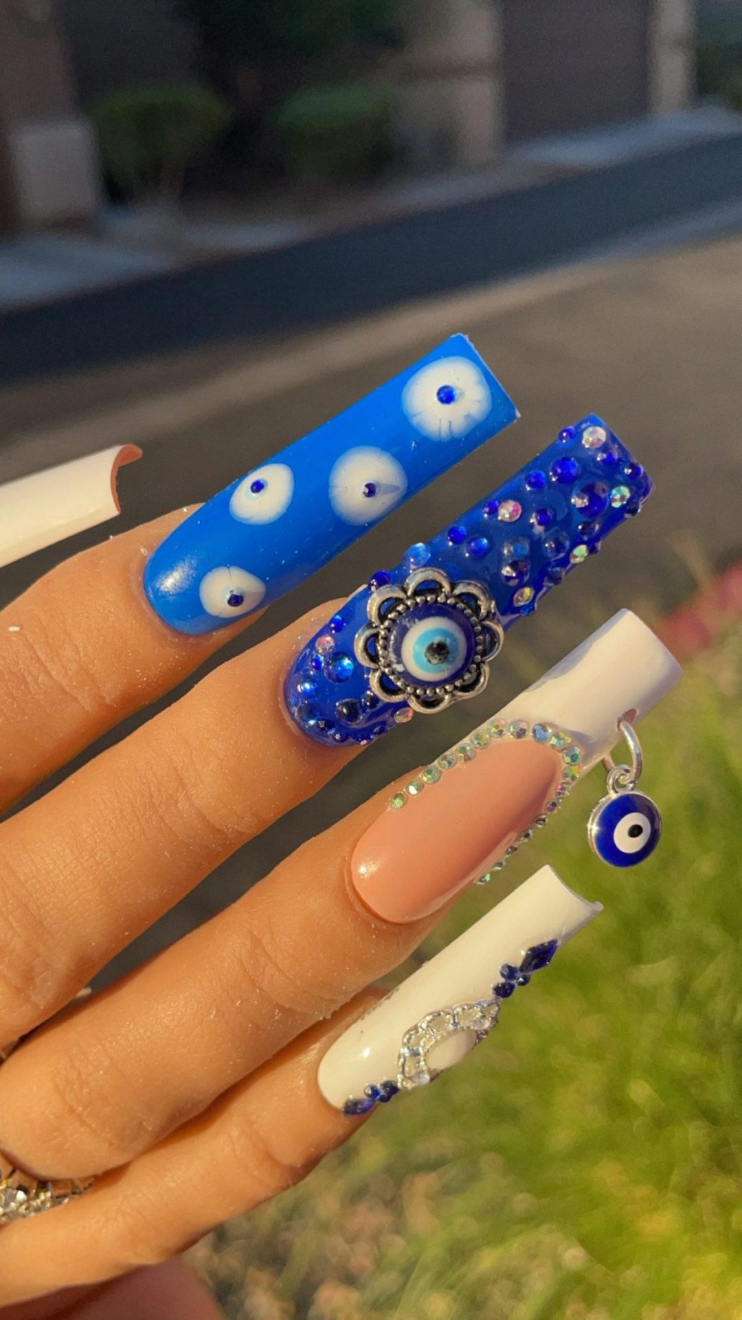 Evil eye nails with embellishments
