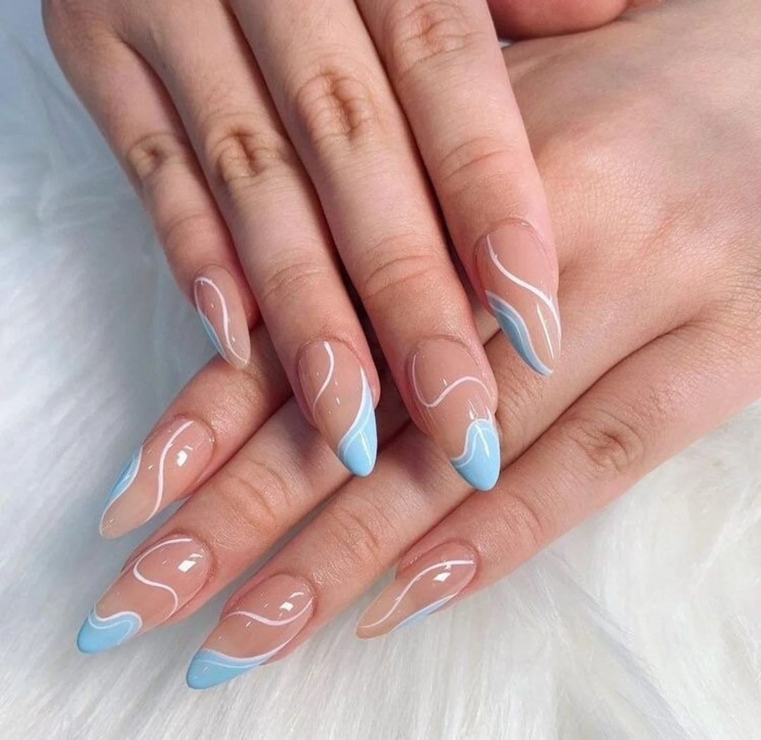 Light blue and white swirl nails