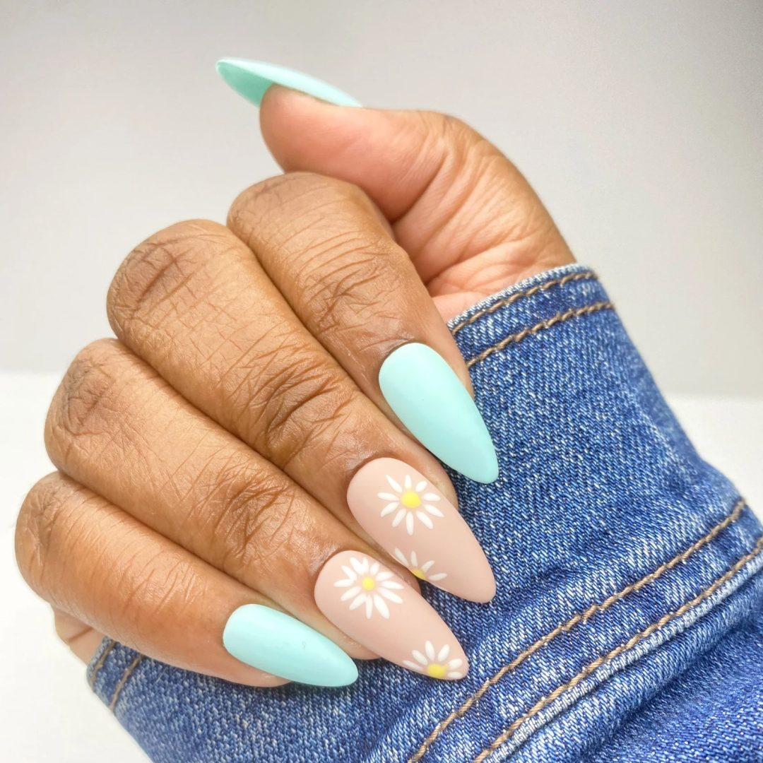 Baby pink and blue daisy nails