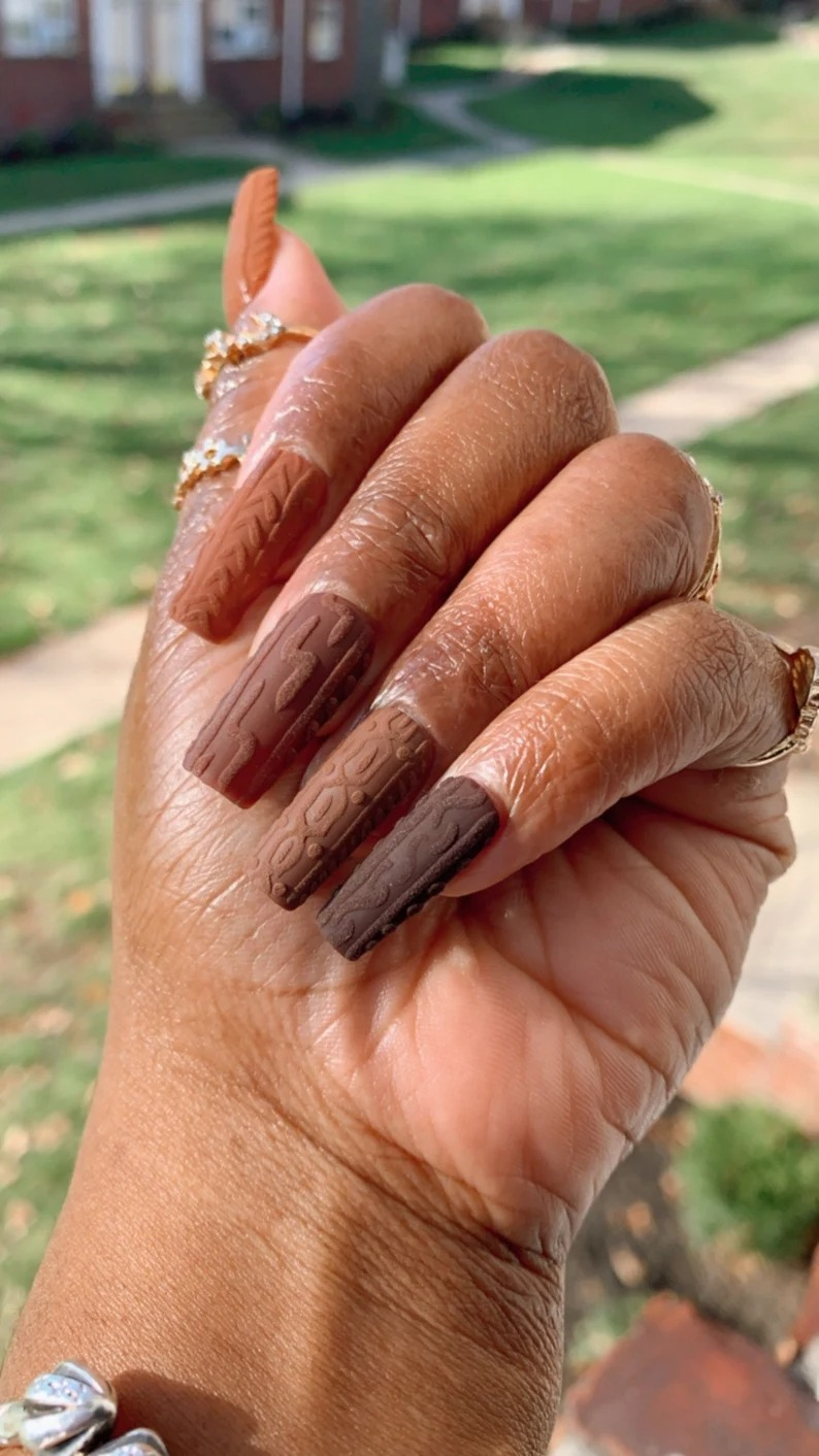 Brown sweater nails