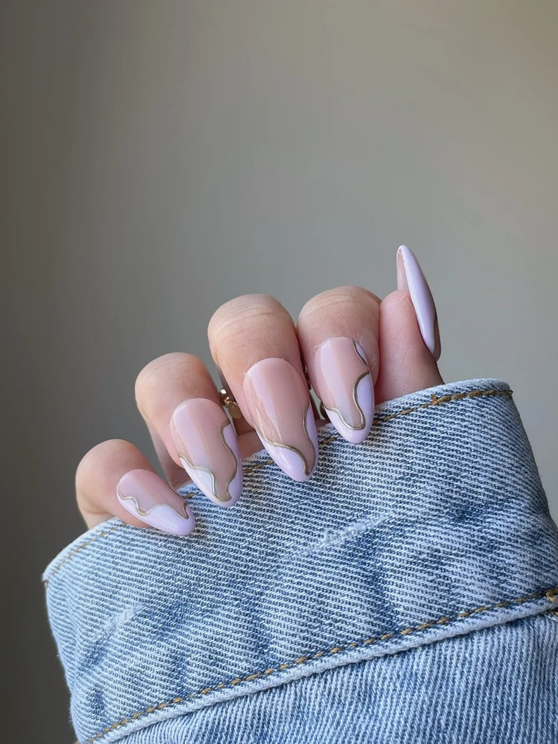 Swirl Nails: Lavender swirl nails with gold detailing