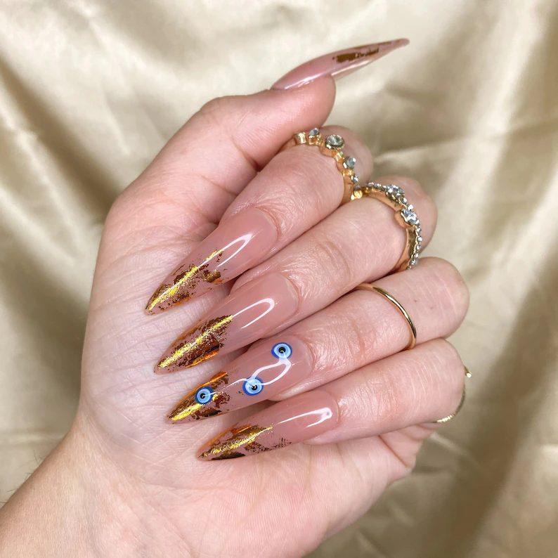 Evil eye nails with gold foil tips