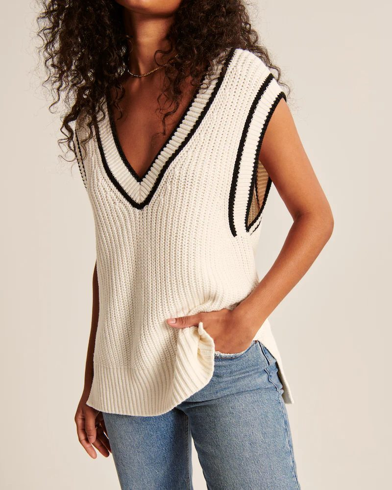 White v-neck knit vest with black stripes