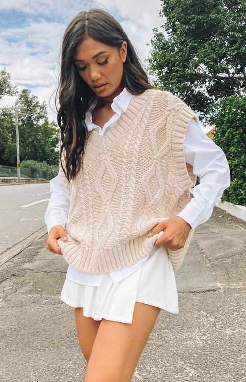 Cute beige sweater vest outfit with white shirt and skirt