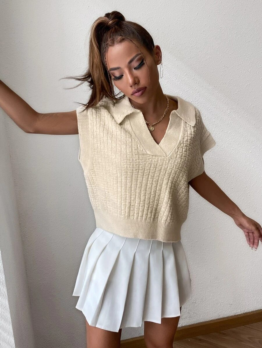 Cute cream sweater vest outfit with white tennis skirt
